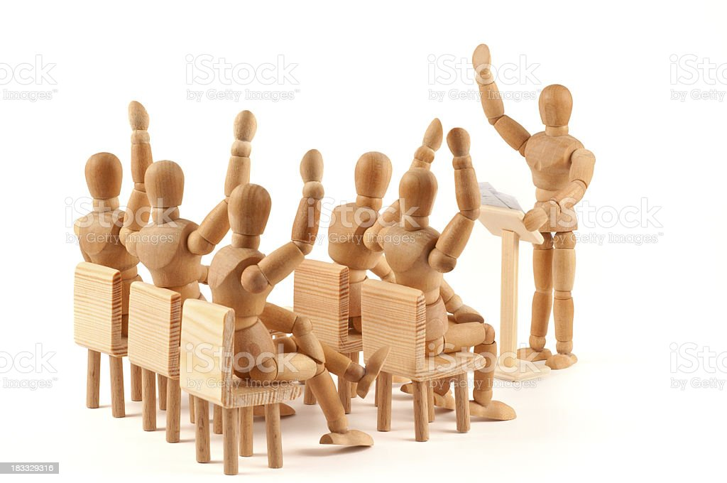 voting at a meeting - decide unanimously by wooden mannequins stock photo