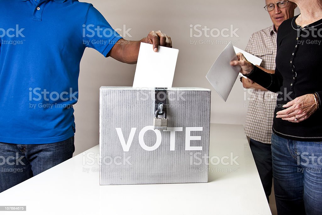 Voting. People in line casting vote. Ballot box.  Multi-ethnic group. stock photo