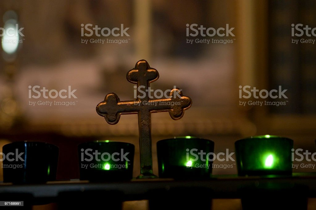Votive candles and cross royalty-free stock photo