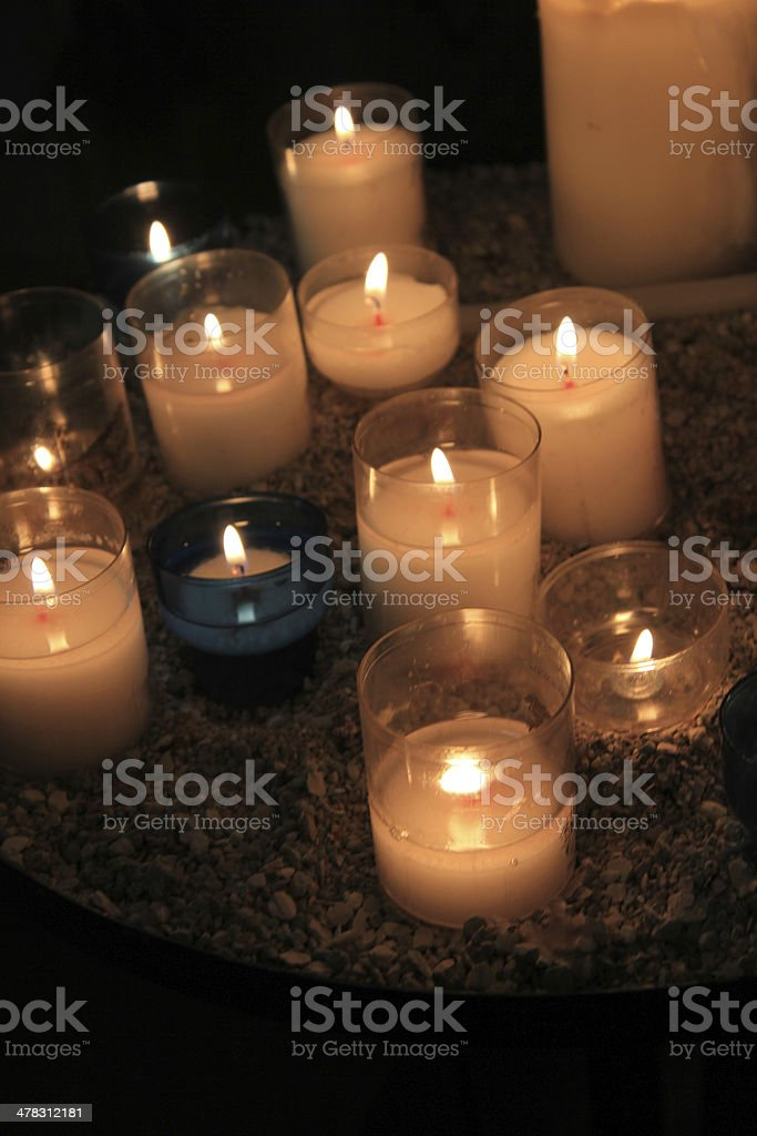 Votive candles in a church royalty-free stock photo