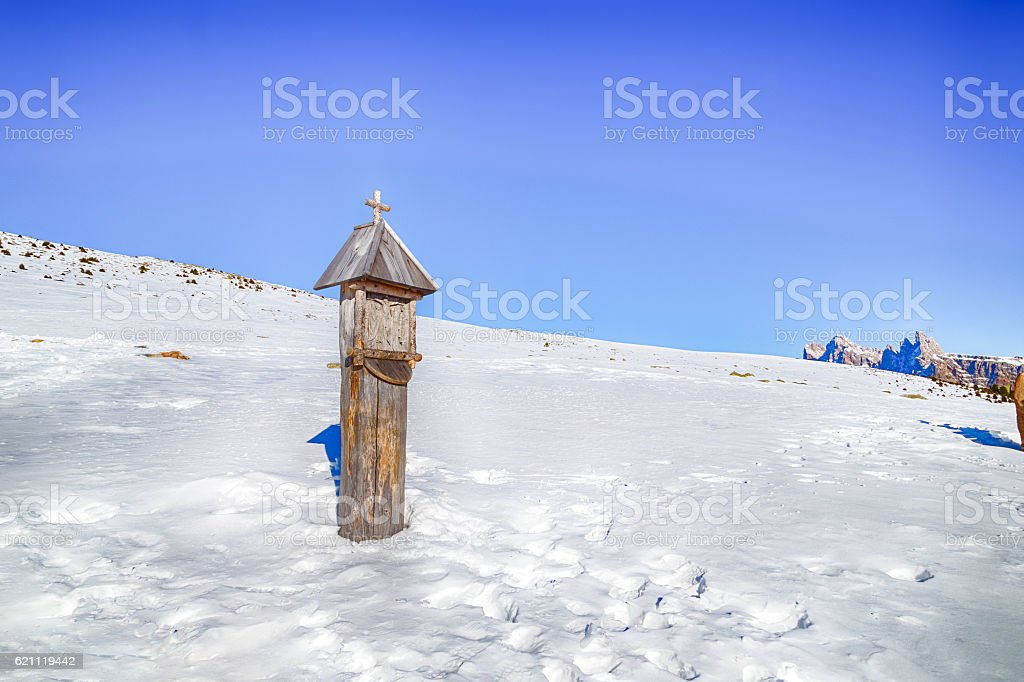 votive shrine in the snow stock photo