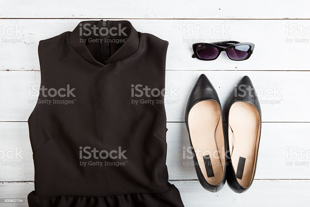 Voyage concept - set of woman stuff on wooden background stock photo