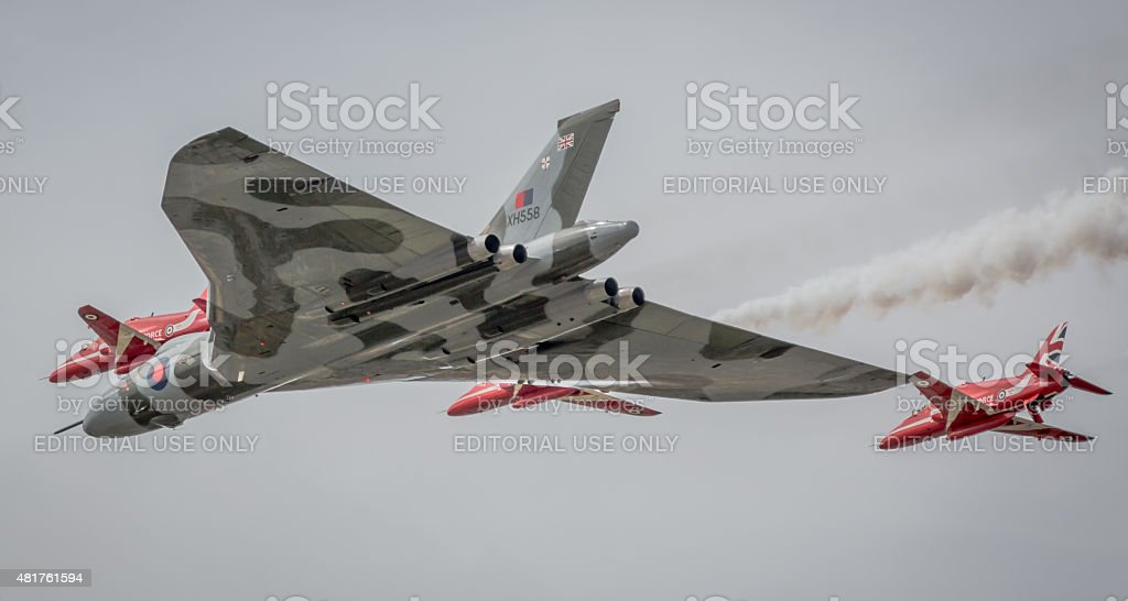 Vulcan & Red Arrows flying together stock photo