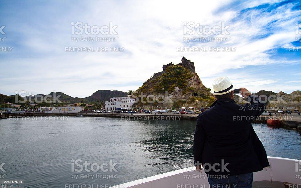 Vulcano, Sicily: Man Taking Picture of Harbor stock photo