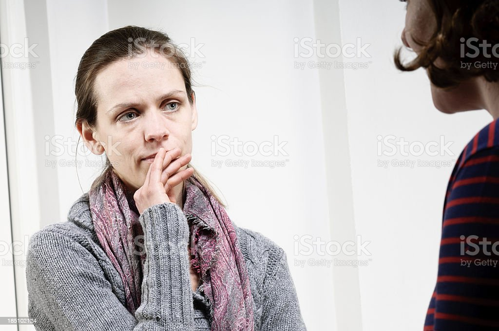 Vulnerable Young Woman In a Counselling Session royalty-free stock photo