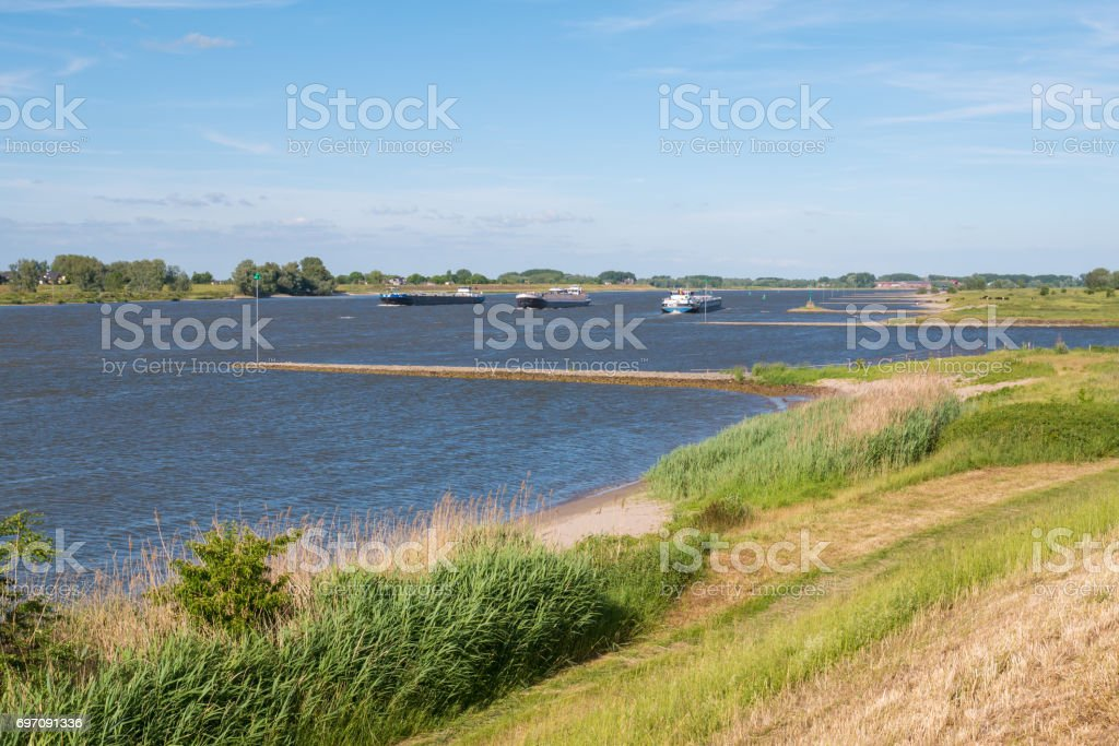 Waal river with groynes and inland shipping, Netherlands stock photo