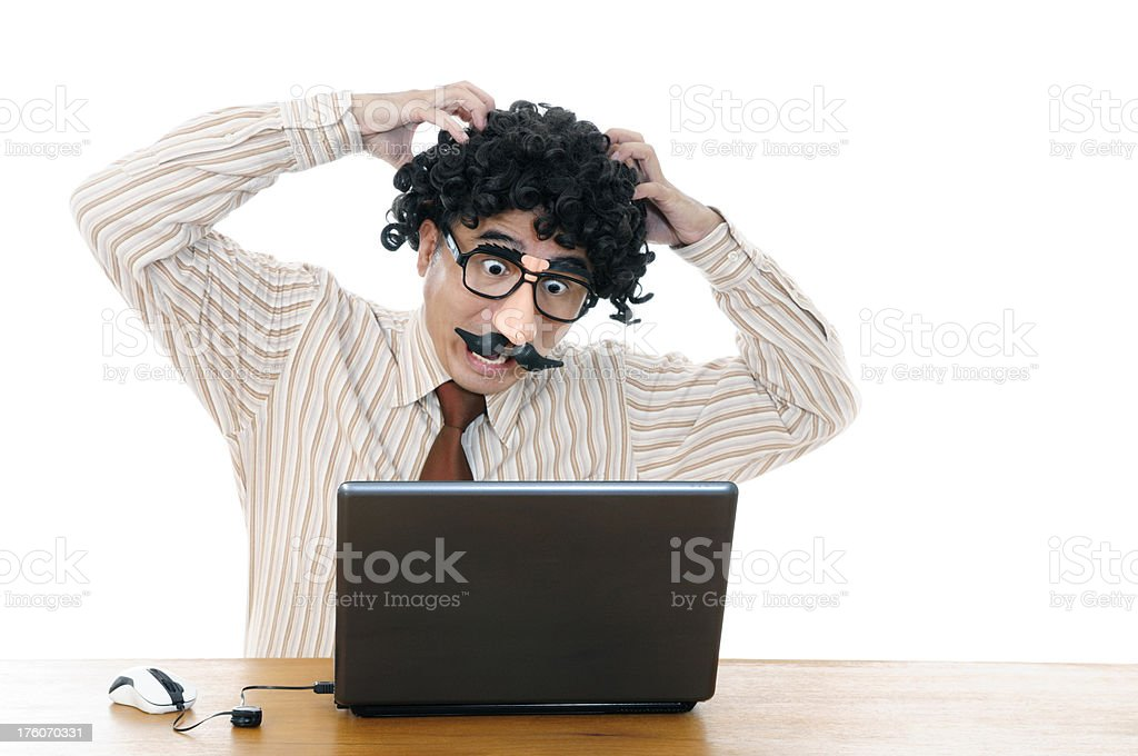 Wacky man with comedy eyeglasses screaming out loud at laptop stock photo