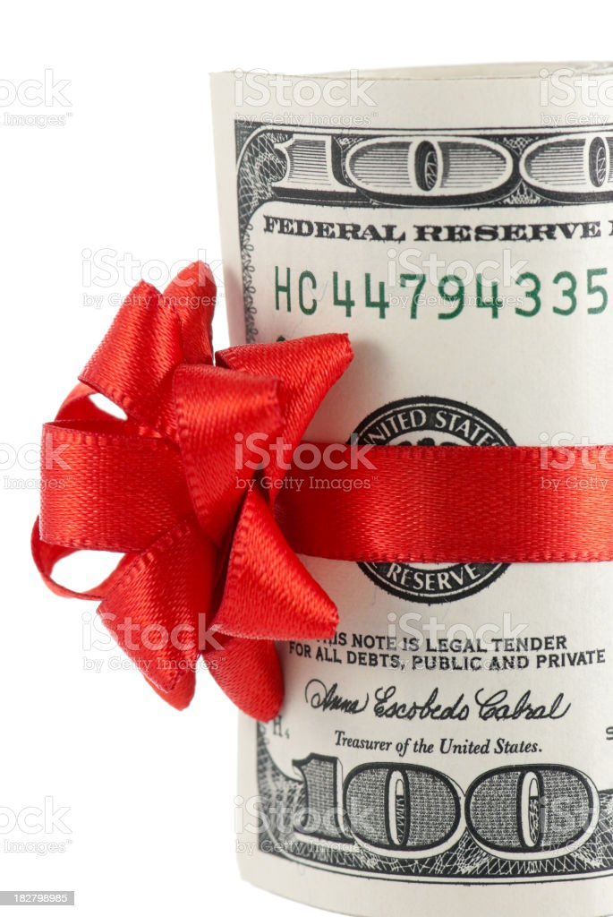 Wad of 100-dollar bills with red ribbon and bow stock photo