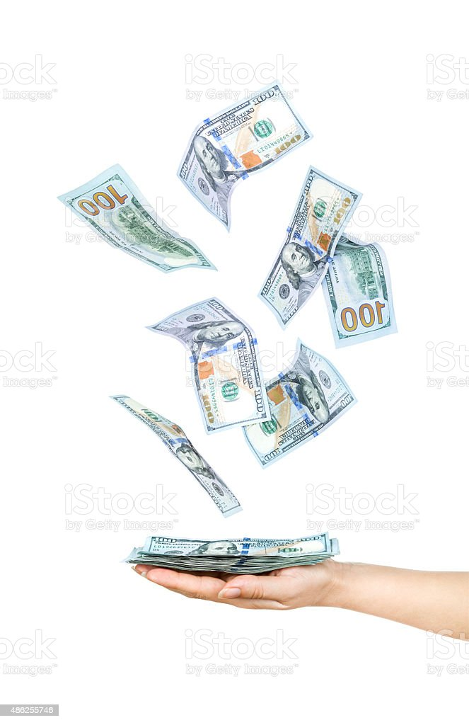 Wad of one hundred dollar bills held in hand stock photo