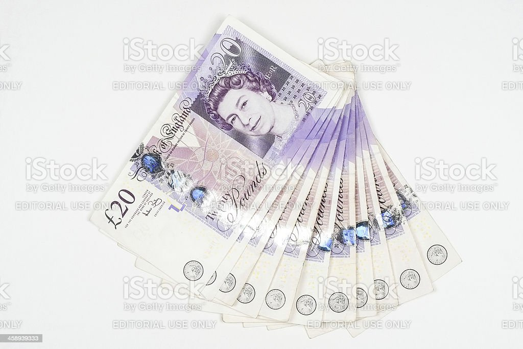 Wad of UK twenty pound notes stock photo
