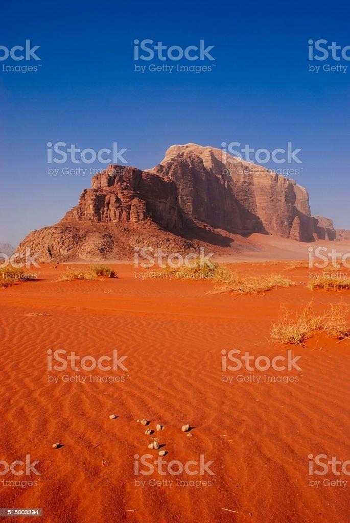 wadi rum desert with rock, jordan stock photo