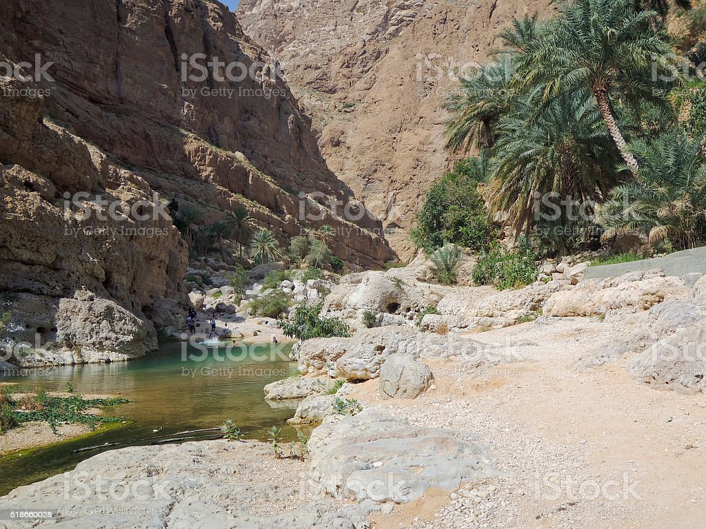 Wadi Shab with emerald green water stock photo