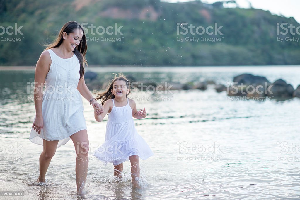 Wading in the Water in Hawaii stock photo