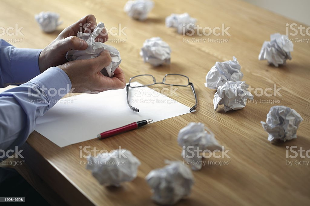 Wads of paper, struggling with writer's block stock photo