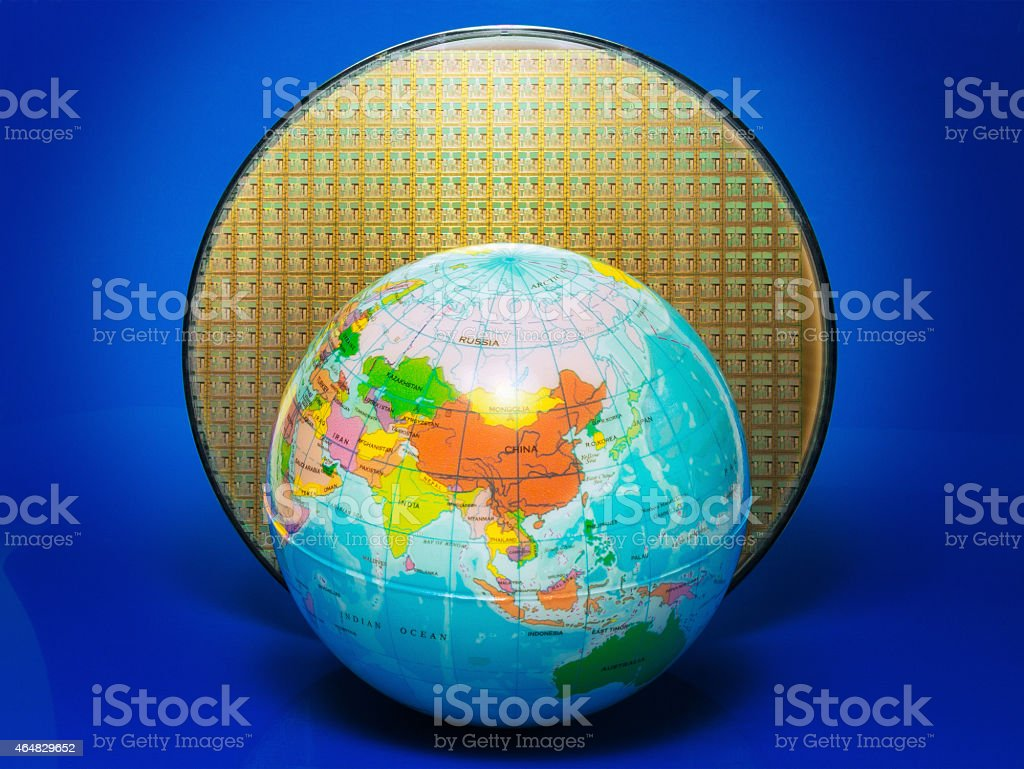 Wafer and globe – focus on China stock photo