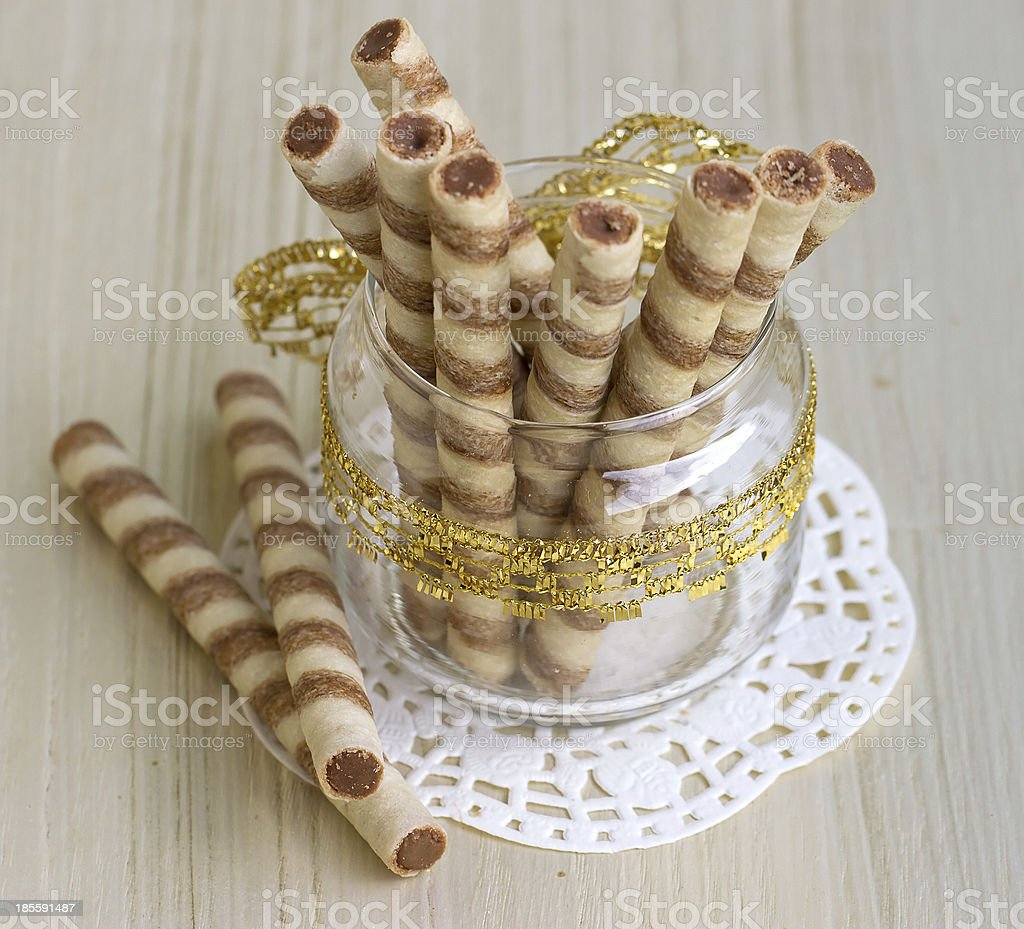 Wafer roll sticks cream rolls in a cup royalty-free stock photo