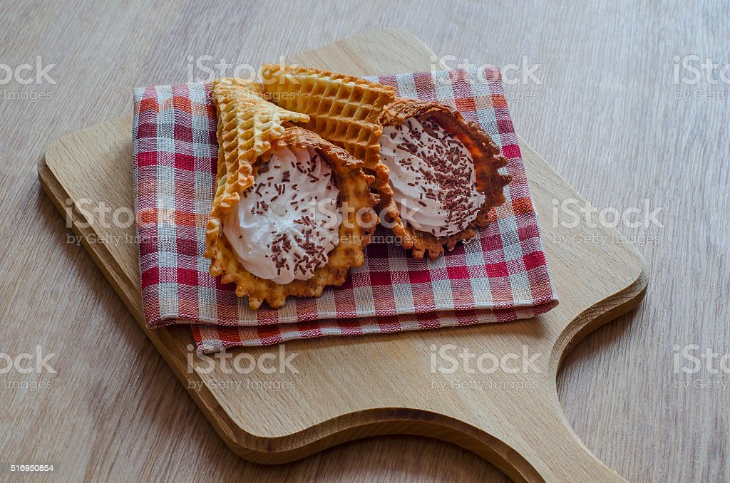 Wafer tubes with cream and chocolate chips stock photo