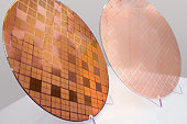 Wafer with elements in Flip-Chip-Montage (left) and processed glass wafer