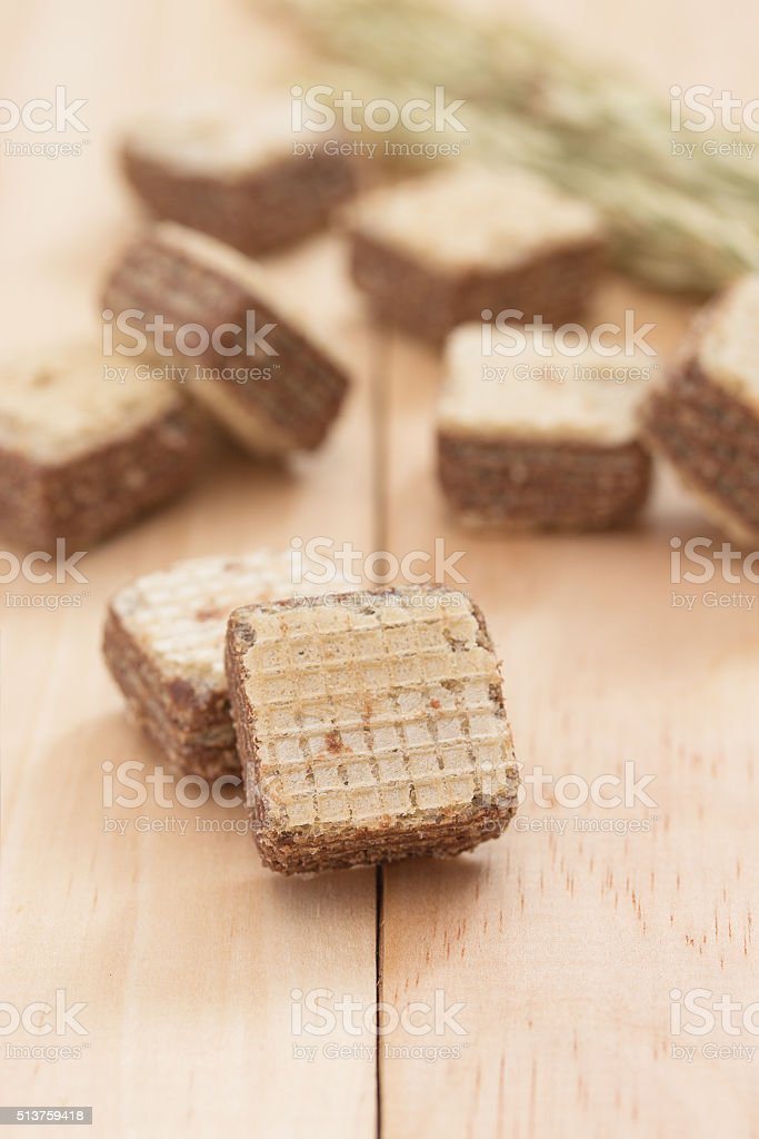 Wafers with chocolate on wooden background. stock photo