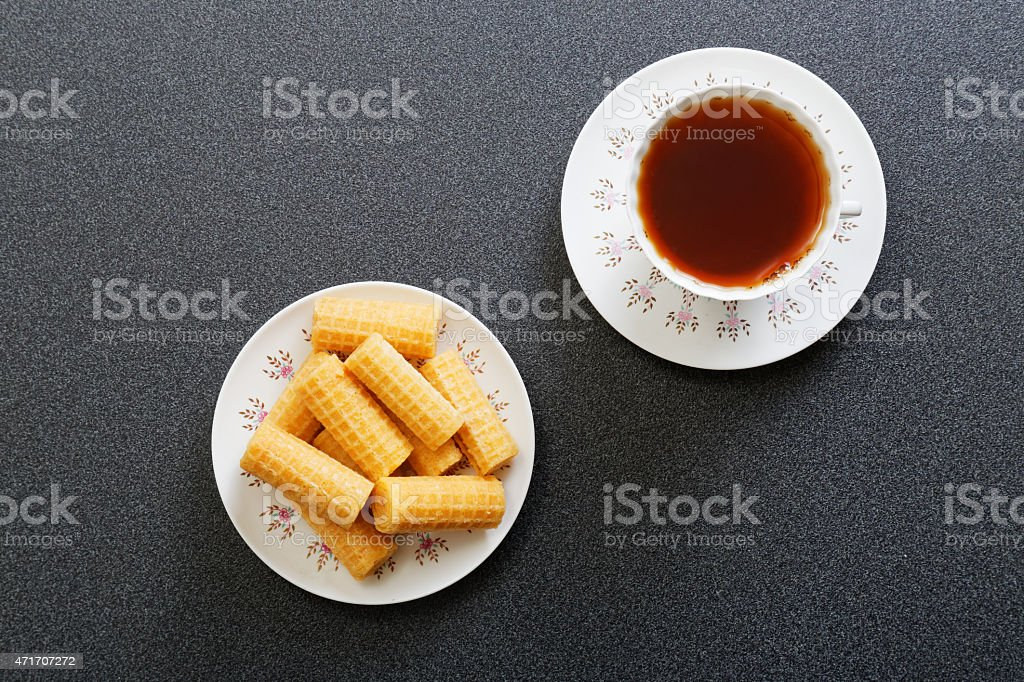 Waffer rolls and cup of china tea. Top view. stock photo