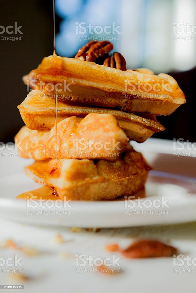 waffle staked and pouring corn syrup stock photo