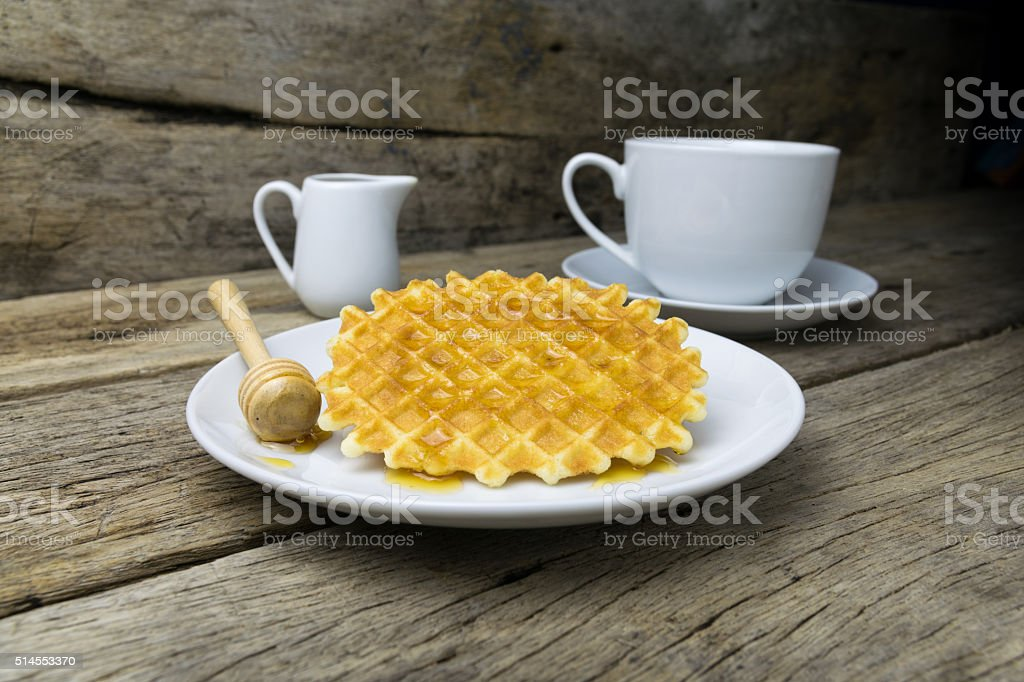 waffle with a cup of Coffee and honey stock photo