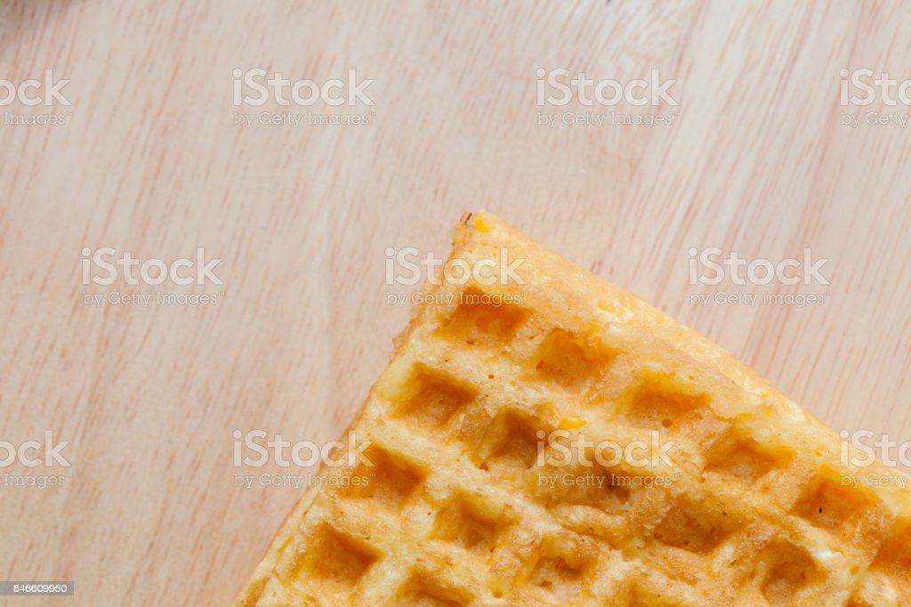 waffle with corn on wooden plate stock photo