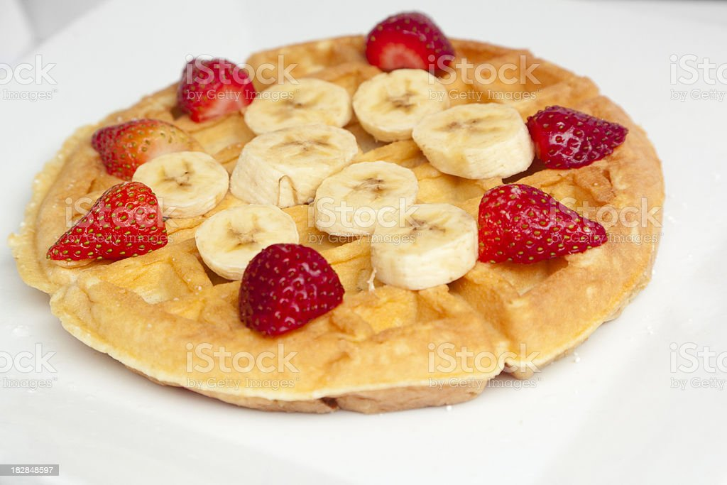 Waffle with Strawberries and Bananas royalty-free stock photo