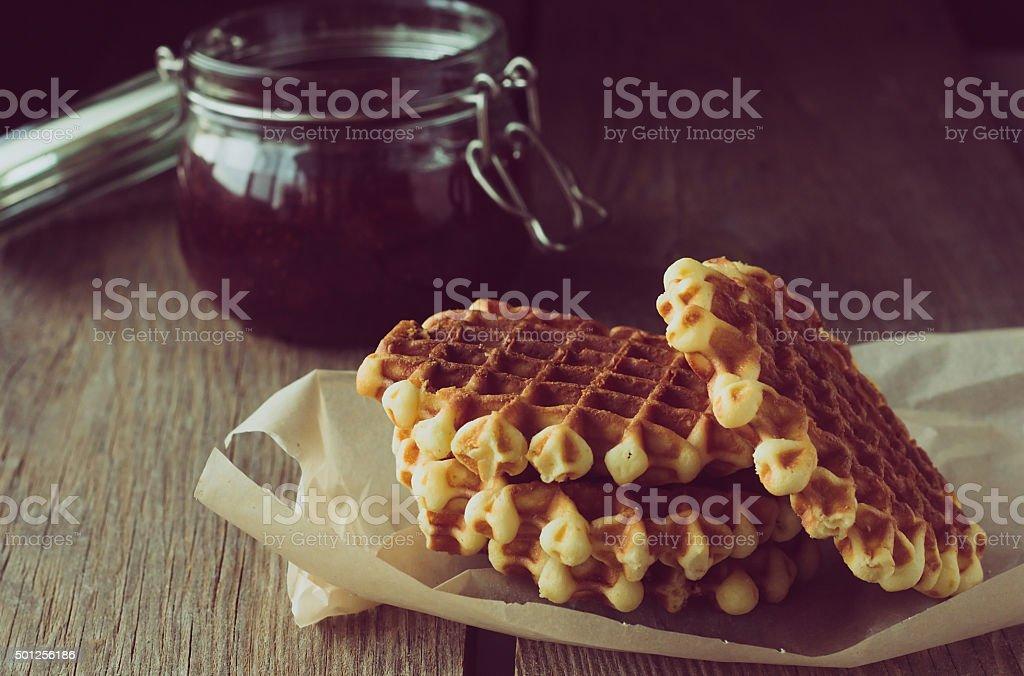Waffles and jam jar stock photo