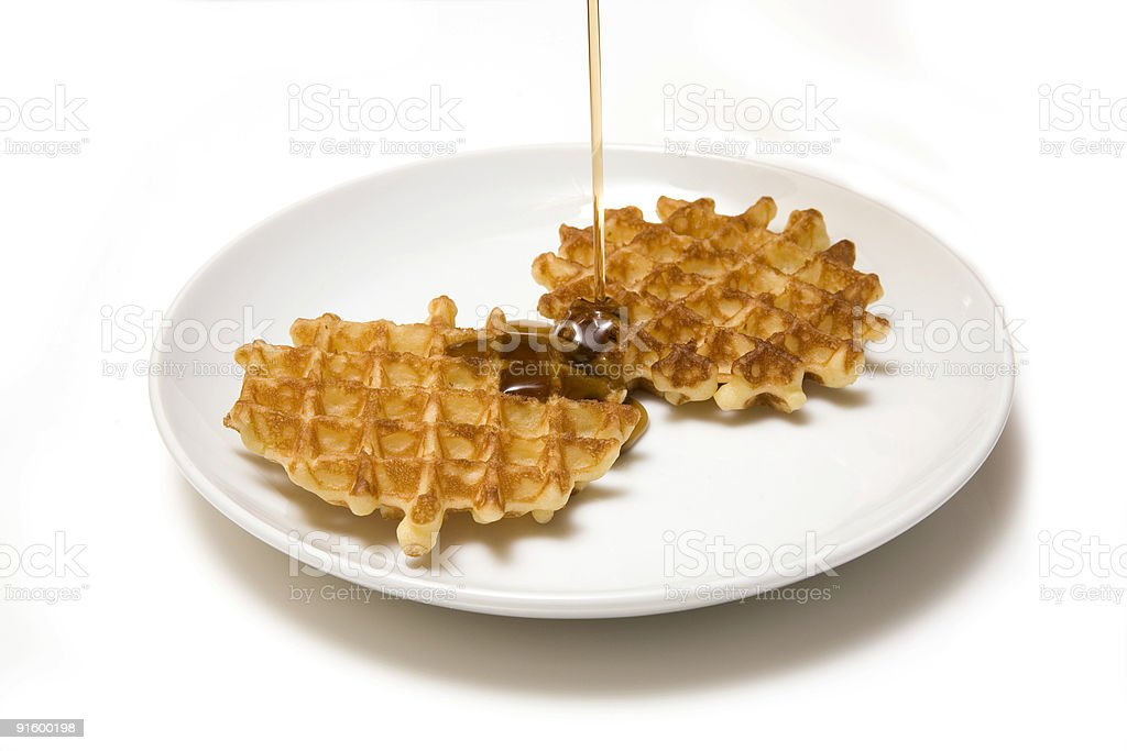 Waffles and maple syrup. royalty-free stock photo