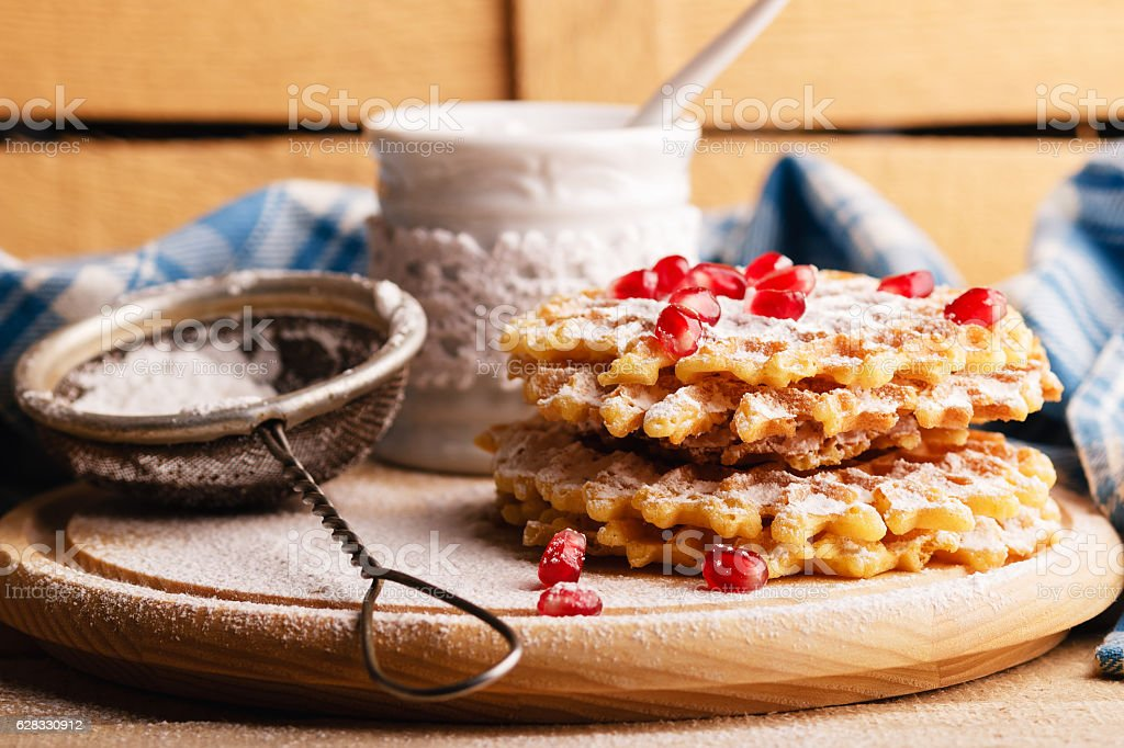 Waffles and sugar bowl with sugar powder and strainer stock photo