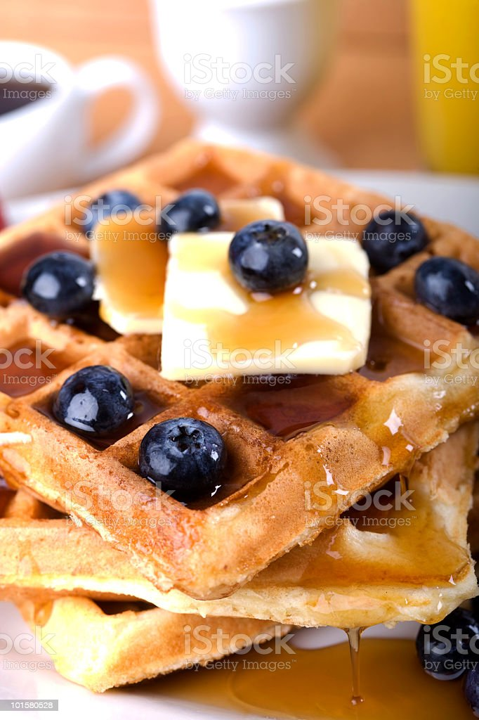 Waffles and Syrup with blueberries stock photo