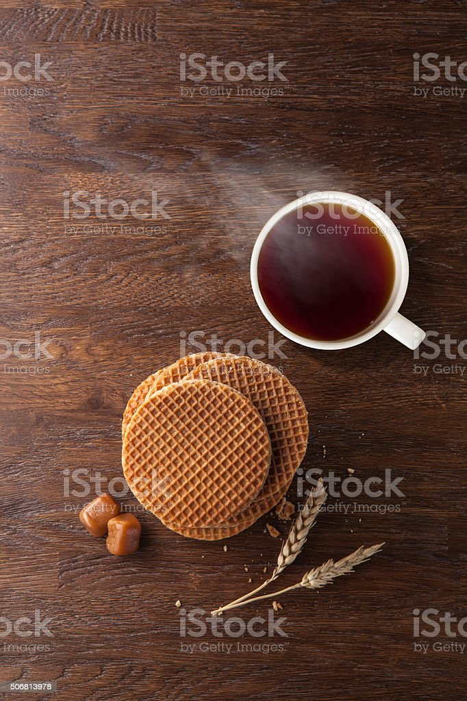 Waffles with caramel and tea on wood stock photo