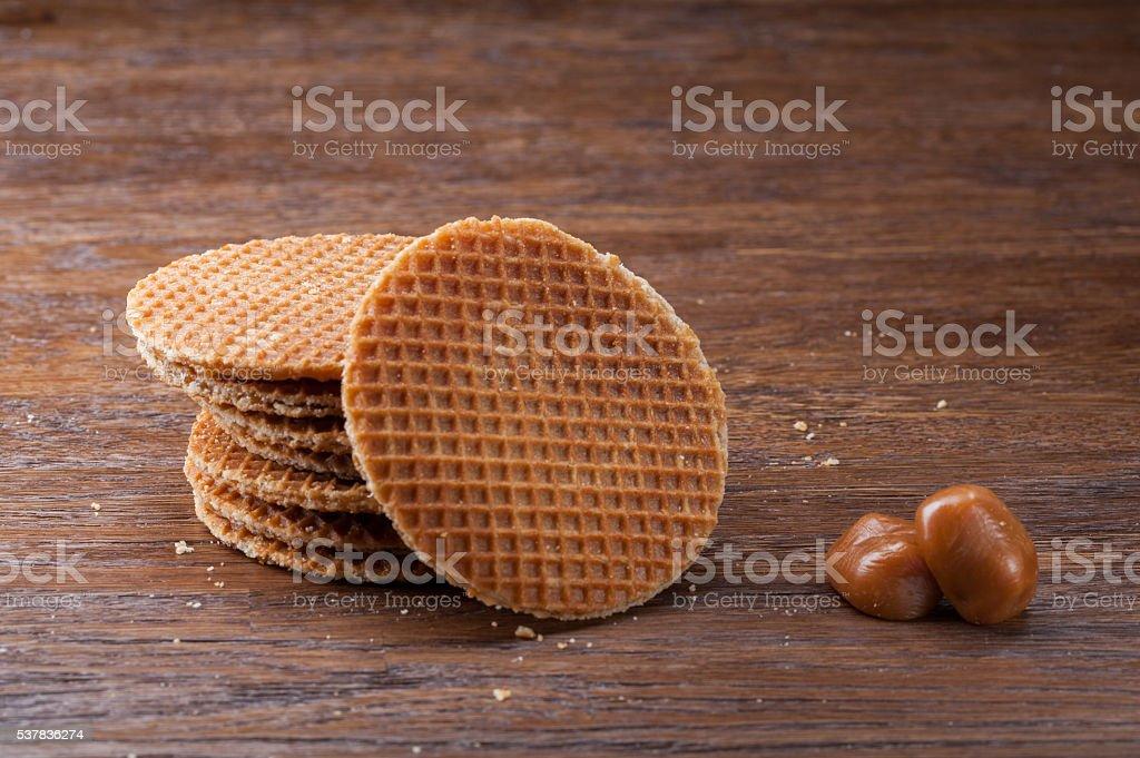 Waffles with caramel on wood stock photo