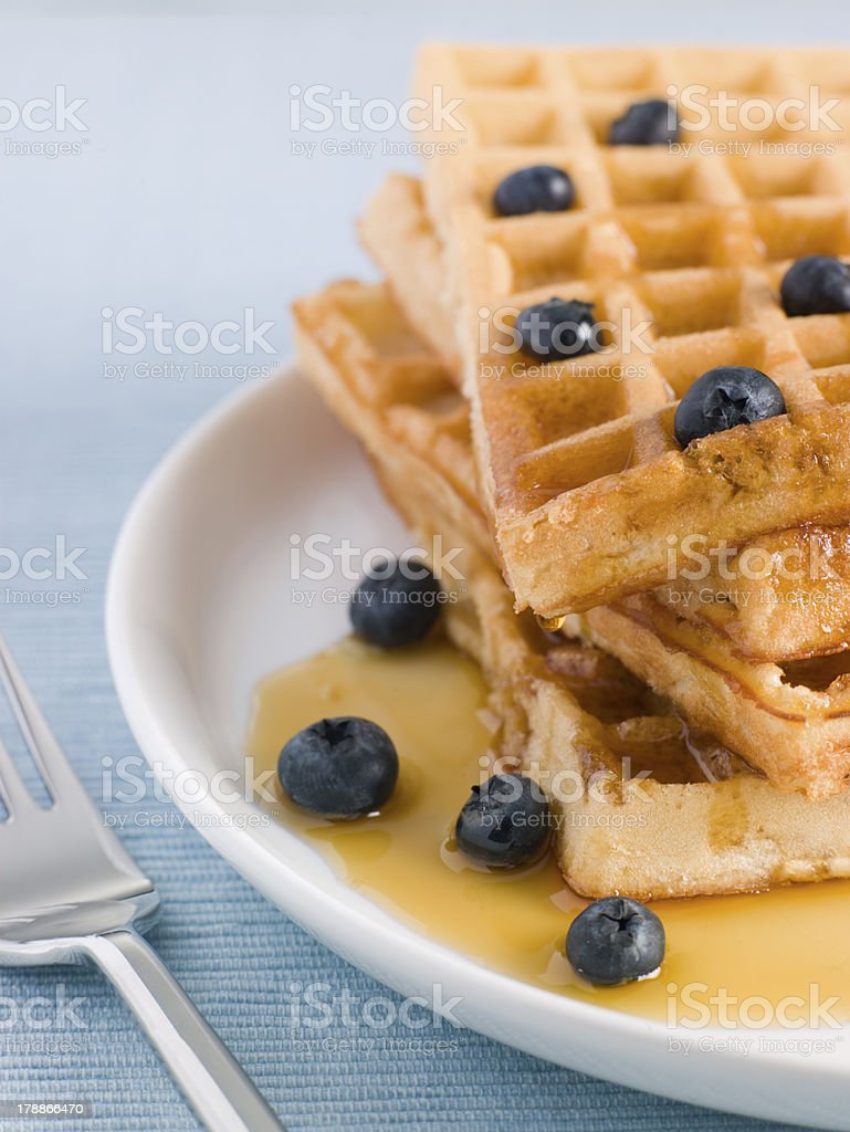 Waffles with Caramel Syrup and Blueberries royalty-free stock photo