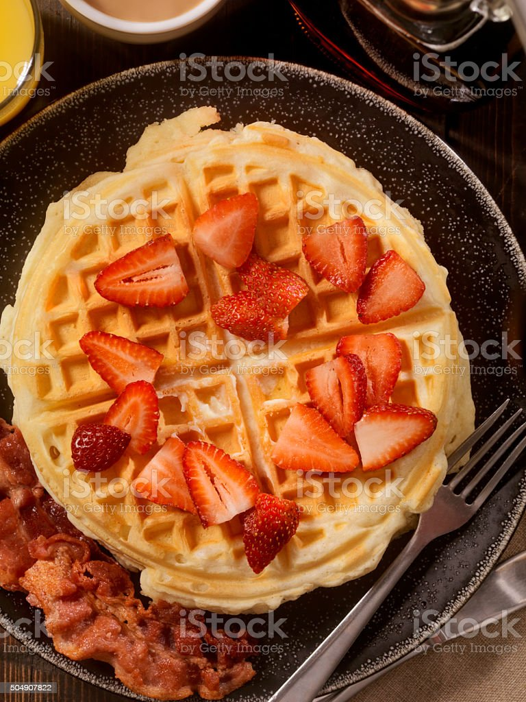 Waffles with Fresh Strawberries and Bacon stock photo