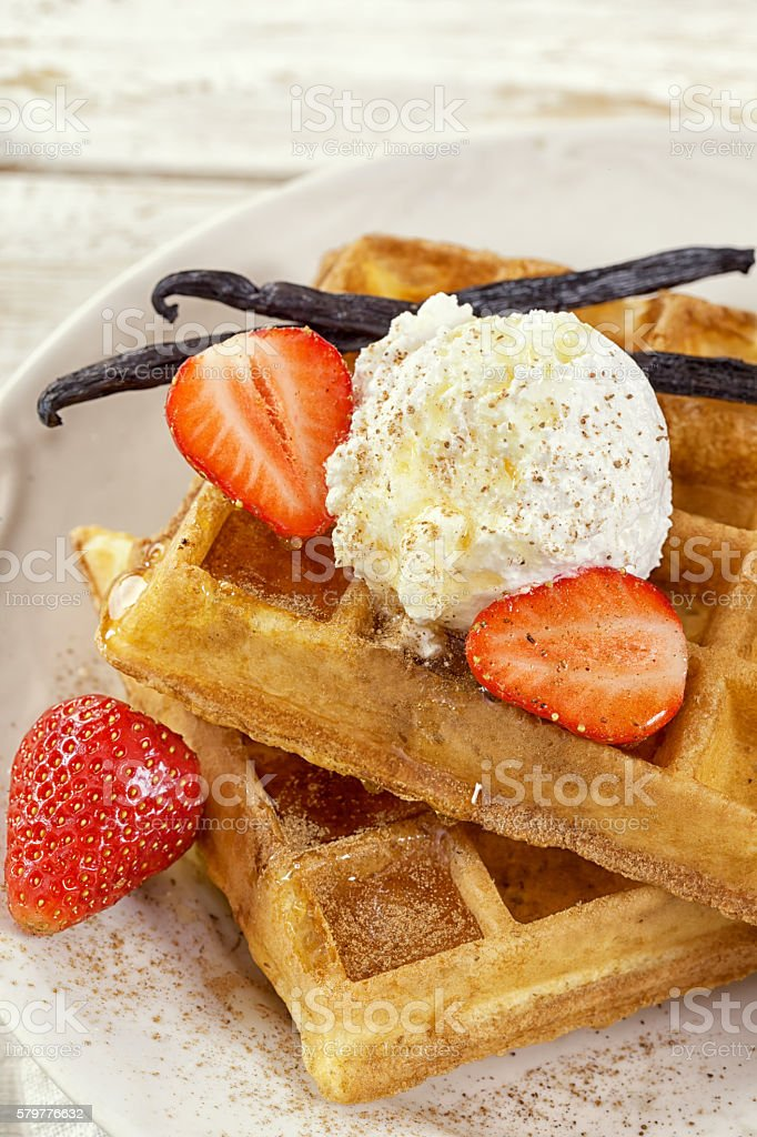 Waffles with Fresh Strawberries and Vanilla beans stock photo