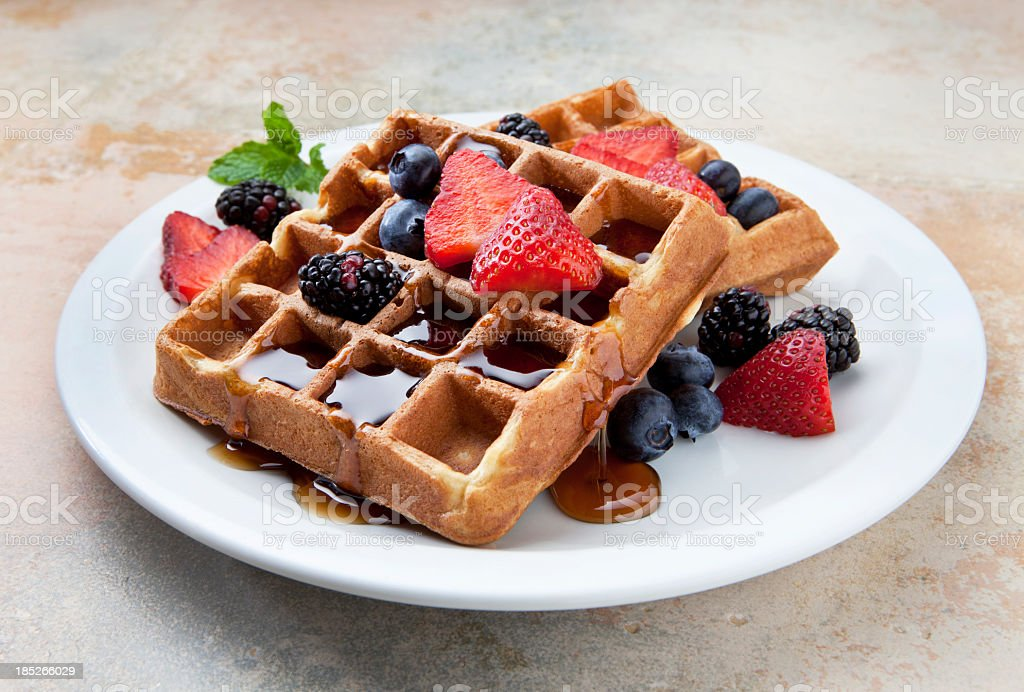 Waffles With Fruit and Maple Syrup on a Marble Counter. stock photo