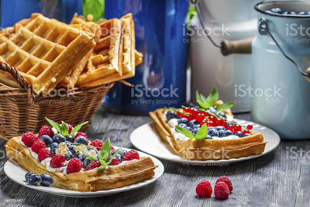 Waffles with fruit and whipped cream royalty-free stock photo