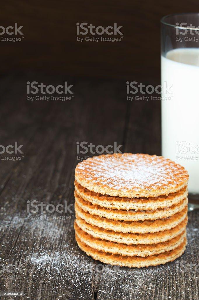 Waffles with milk on dark rustic wood stock photo
