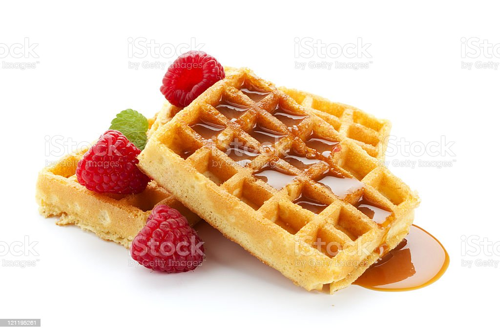 waffles with raspberries and caramel sauce stock photo