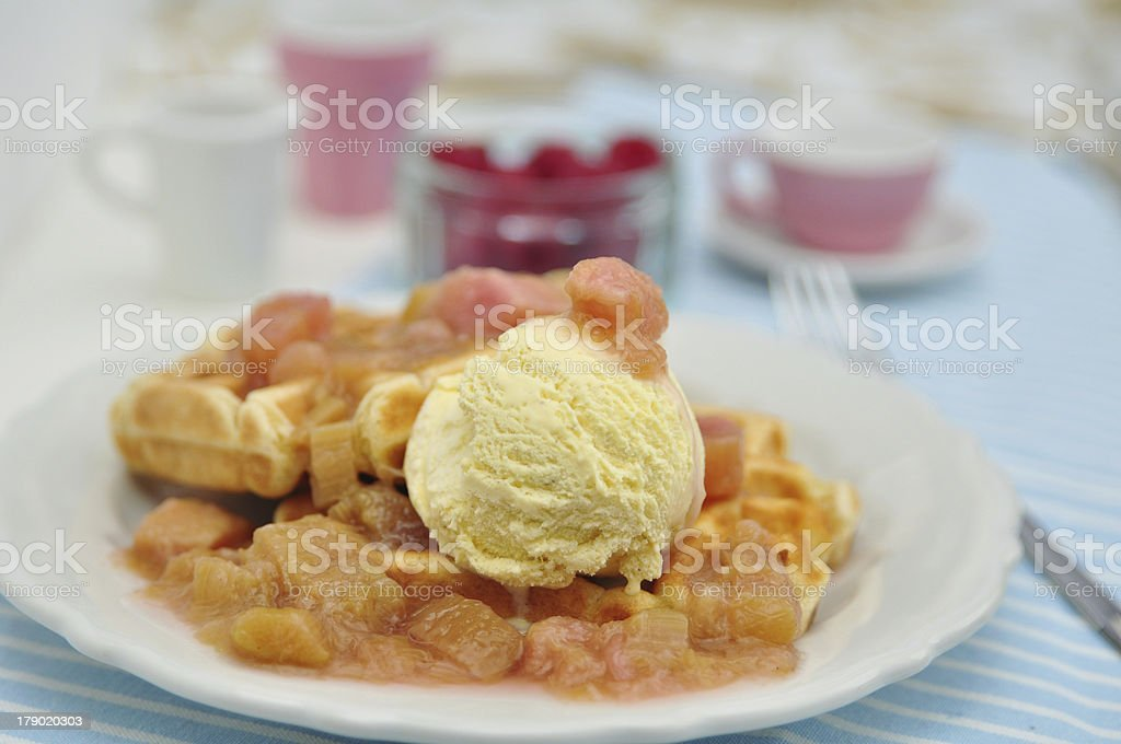 Waffles with Vanilla Ice Cream and Rhubarb Compote royalty-free stock photo