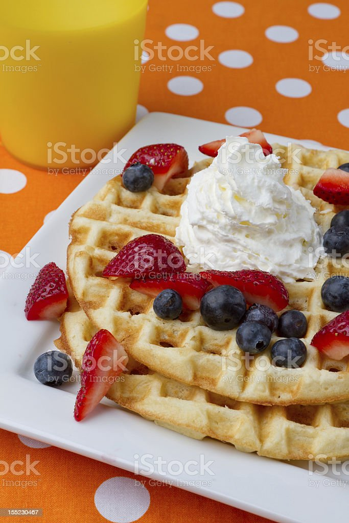 Waffles with Whipped Cream and Berries royalty-free stock photo