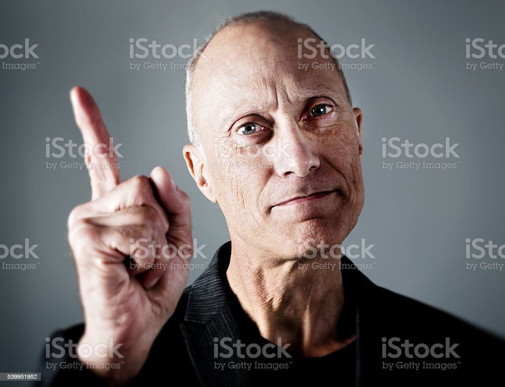 wagging finger, serious mature man, ticking off, remonstrating, boss, manager, stock photo