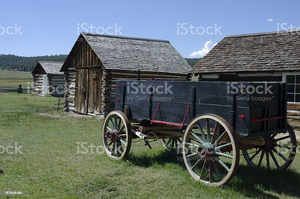 Wagon and Log Cabins at Hornbek Ranch stock photo