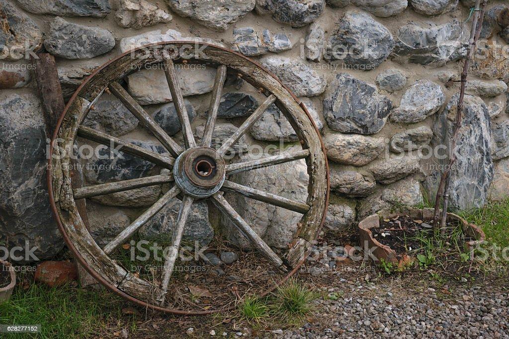 wagon wheel on wall stock photo