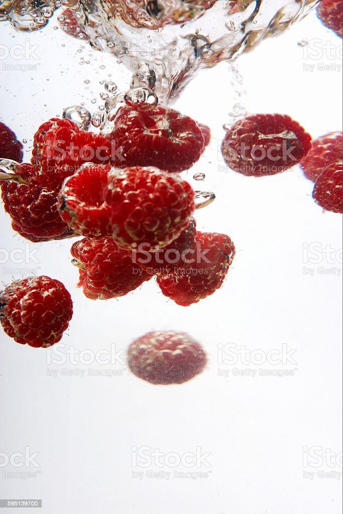 Wahing Raspberries stock photo