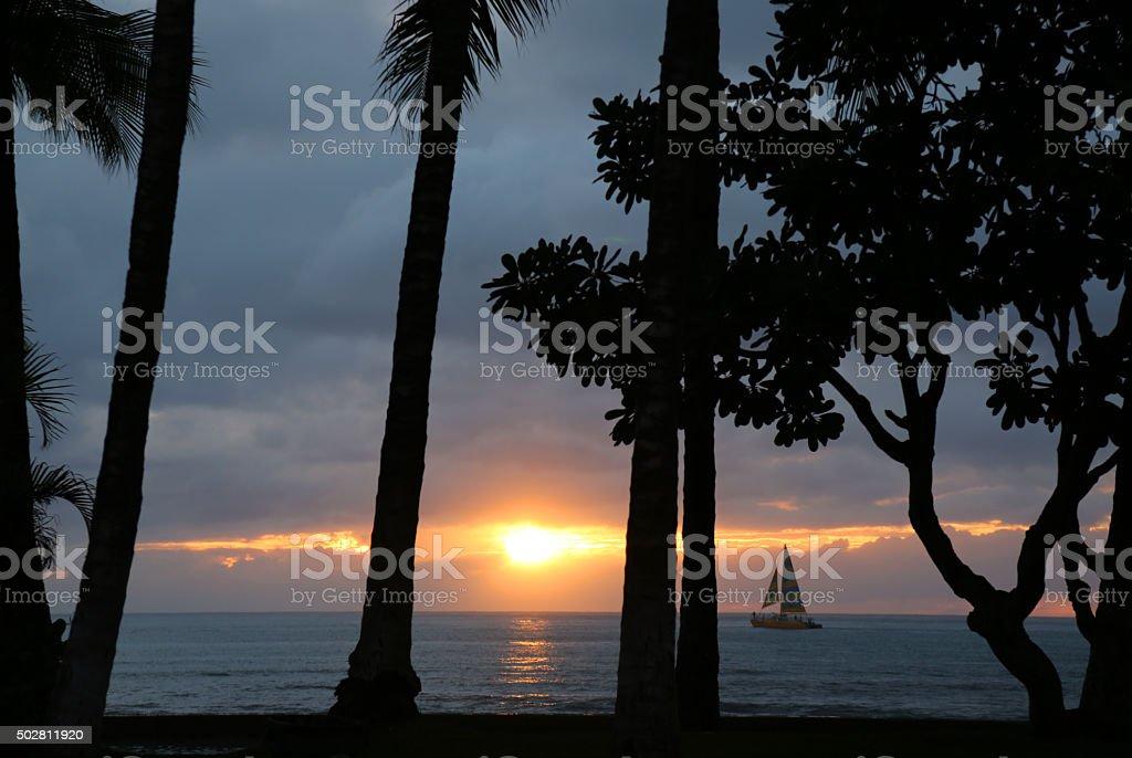 Waikiki Beach Sunset and Sailboat stock photo