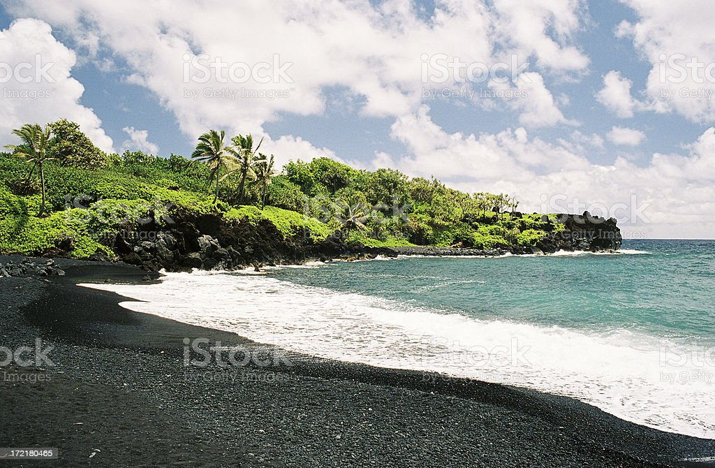 Wainapanapa black sand beach on Maui Hawaii stock photo