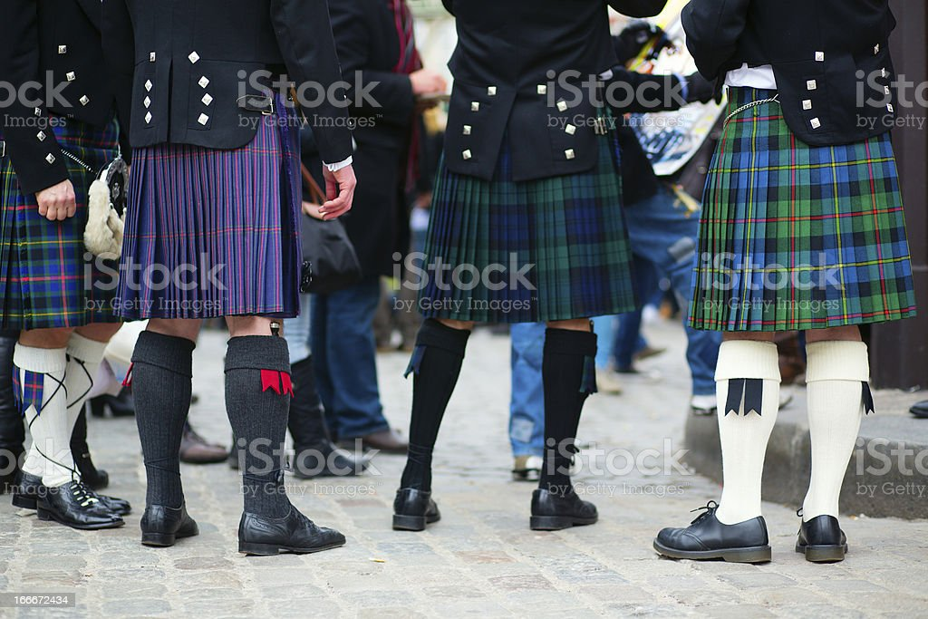 Waist down view of a group of men in traditional kilts stock photo